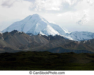 Denali National Park - Snow-capped mountains provide a...