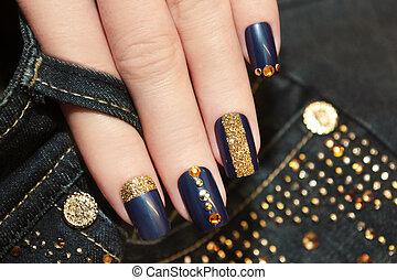 Denim blue manicure.