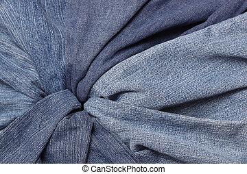 Denim - Collection of well worn blue jeans form a vortex
