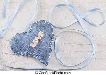 Denim heart with the word love on it