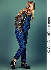 denim overalls - Beautiful fashion model posing at studio....