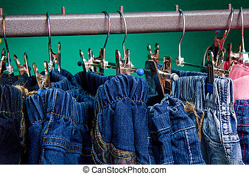 Denim pants on a hanger for children in the store