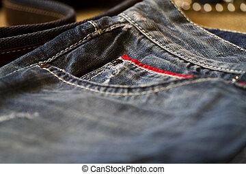 Worn blue denim pants