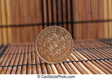 Denmark coin denomination is 2 krone (crown) lie on wooden bamboo table, good for background or postcard