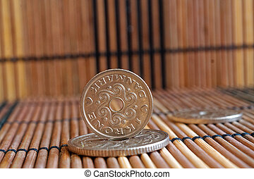 Denmark coins denomination is 5, 2 and 1 krone (crown) lie on wooden bamboo table, good for background or postcard