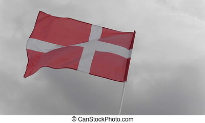 Denmark flag on the flagpole waving in the wind against a...
