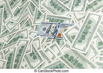 Denominations of one hundred dollars. Background of banknotes. Dollar background.