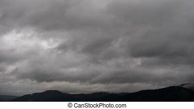 Dense Cloud Cover Drifts over Hilltops in Timelapse - Dense...