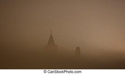 Dense fog around building at night timelapse footage