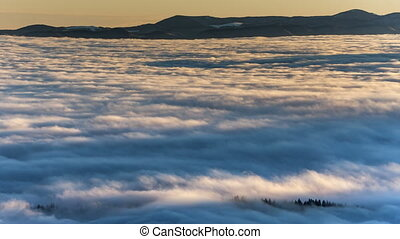 Dense fog rolling through Carpathian mountains. winter...