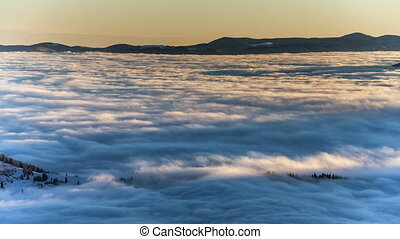 Dense fog rolling through Carpathian mountains. winter...