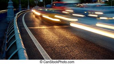 Dense urban car traffic at night