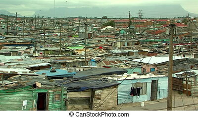densely populated township outside cape town, south africa -...