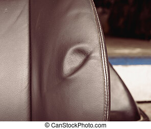 Dent on leather seat - A dent, pressure mark indentation on...
