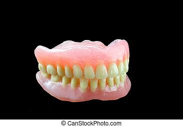 dentadura llena, en, fondo negro