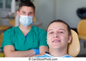 Dental braces - Patient with a dental braces at the clinic