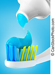 Dental brush and tube with paste.
