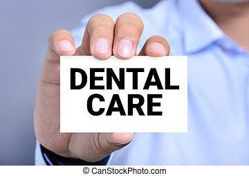 DENTAL CARE message on the card held by a man hand