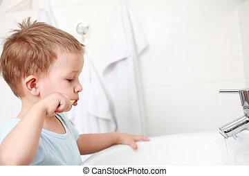 Dental care  - small boy washing his teeth
