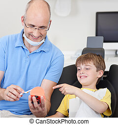 Dental care prevention - Dentist gives a dentalcare...