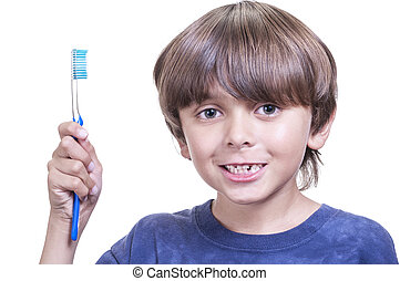 Dental care - Portrait of young boy holding toothbrush,...