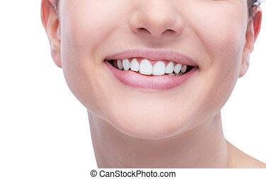 Dental care - Beautiful young woman smiling an showing...