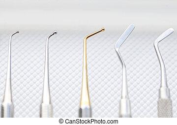 Dental cavity filling instruments