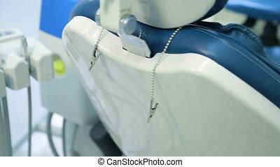 Dental chair and unit assistant or nurse closeup. Armchair...