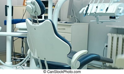 Dental Chair Is Folded Automatically In Dentist Office....
