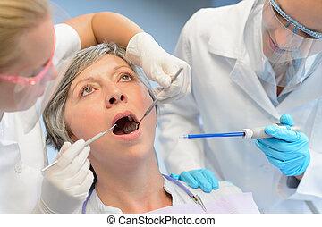 Dental check elderly woman patient dentist team