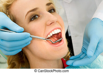 Dental checkup - Close-up of young woman during inspection ...