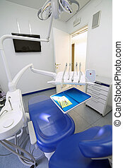 Dental clinic with special chair and dental care equipment photo