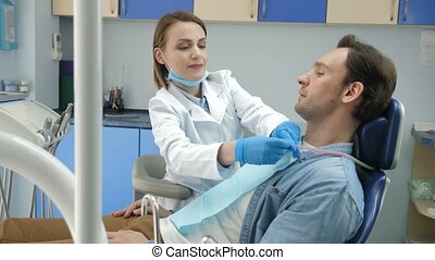 Dental doctor preparing patient for treatment
