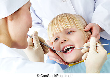 Dental examination - Image of little girl having teeth...