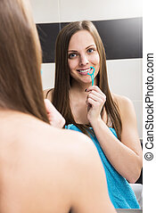 Dental floss - Portrait of young woman flosses her teeth...