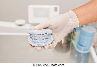 Dental gypsum model plaster with doctor hand grapping