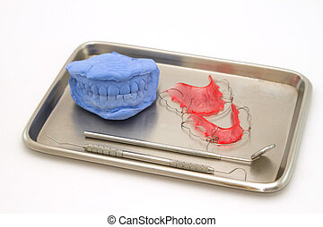 Dental gypsum models and dental brace (Retainer) in medical tray