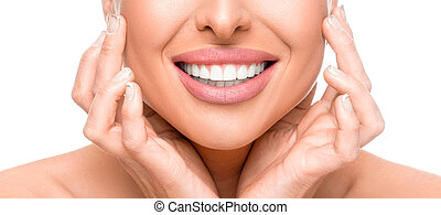 Dental health concept: woman touching face and smiling close up. Isolated on white.