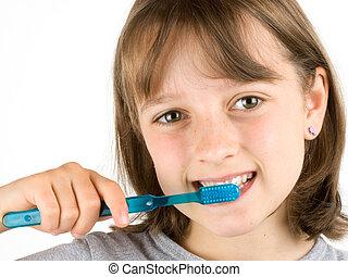 Dental Health - Girl brushing her teeth against a white ...