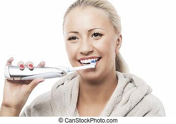Dental Hygiene Concept:Caucasian Woman Brushing Her Teeth...