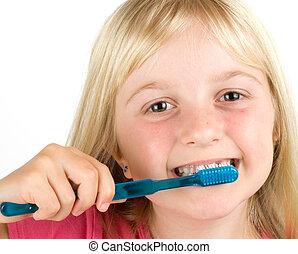 Dental Hygiene - Girl brushing her teeth against a white ...