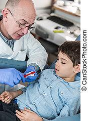 Dental Hygiene - Dentist with little boy, talking about...