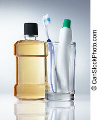 dental hygiene - few kind of dental hygiene products on grey...