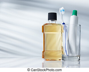 dental hygiene products on grey background with copy space