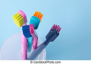 Dental hygiene - Four toothbrushes - dental hygiene. Top...