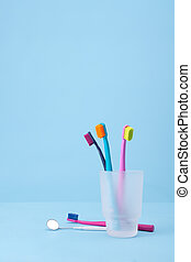 Dental hygiene - Four toothbrushes and speculum (dental...
