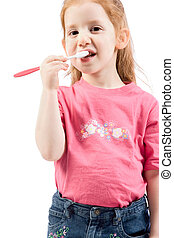 Dental hygiene Young red head girl brushing teeth