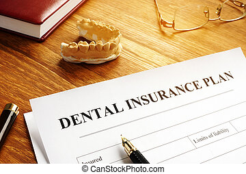 Dental insurance plan policy and glasses.