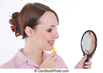 Dental nurse cleaning teeth