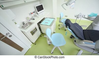 Dental surgery with chair and other equipment, panoramic motion